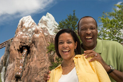 Smiling couple in front of Expedition Everest.