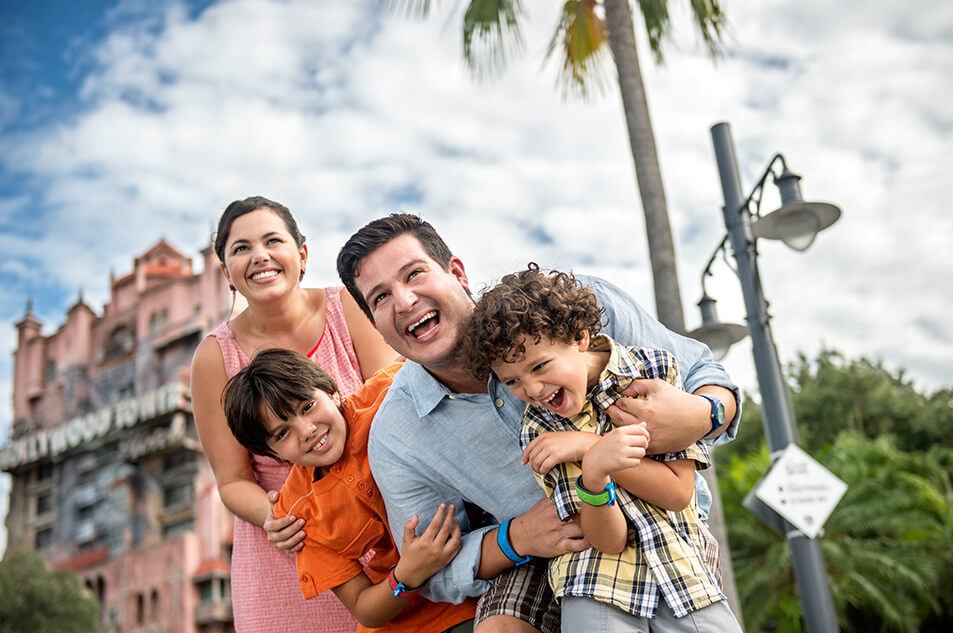A family laughing in front of the Tower of Terror<sup>&#153;</sup>