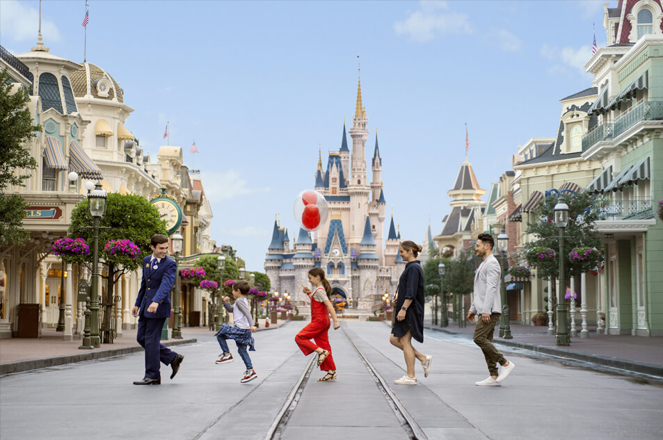 A family crossing Main Street U.S.A.