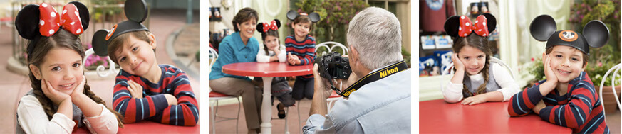 A photographer taking photos of children wearing Micky ears.