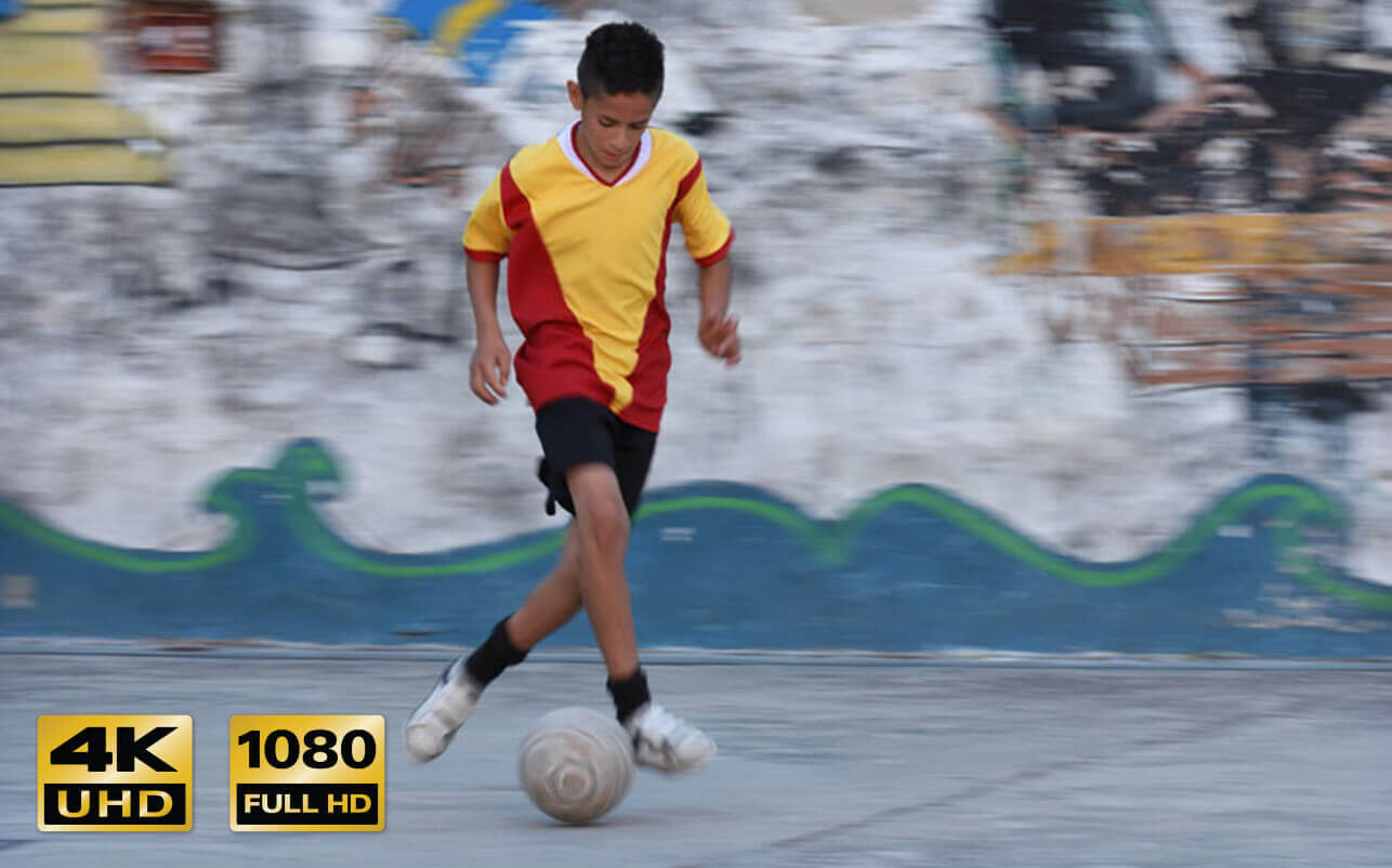 Screencapture from a video of a child playing soccer