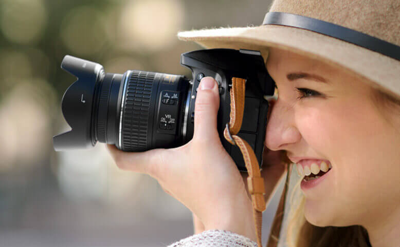 Woman shooting photos with a Nikon DSLR