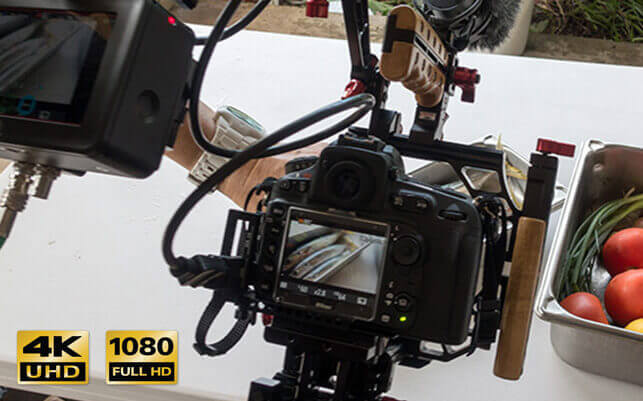 Behind the scenes photo showing a Nikon DSLR recording video