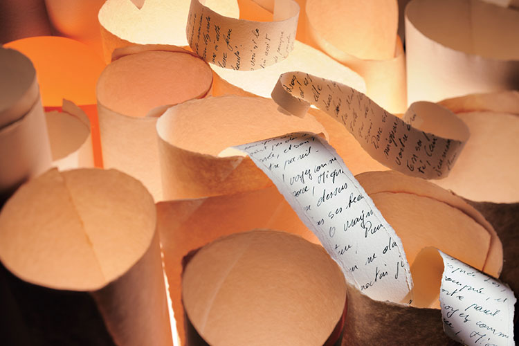 Rolls of scroll-like paper with handwriting