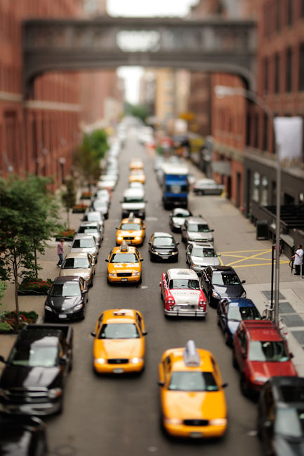 A miniature effect on a city street packed with cars