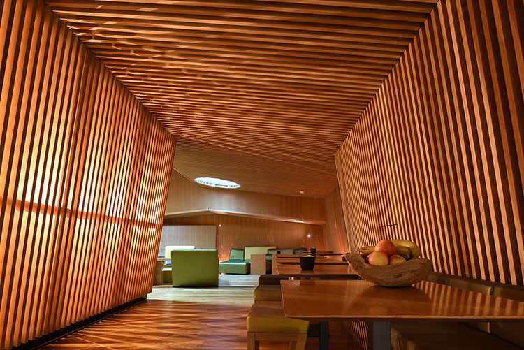 Looking down a hallway covered with a wood slatted design