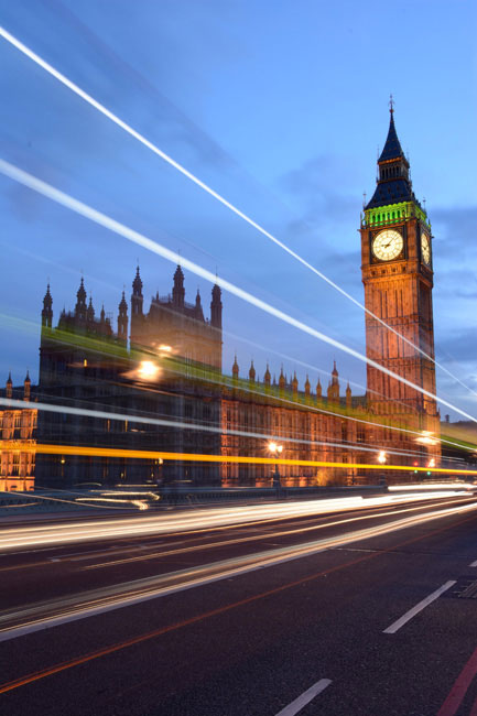 Big Ben clock tower with light trails from vehicles in the foreground