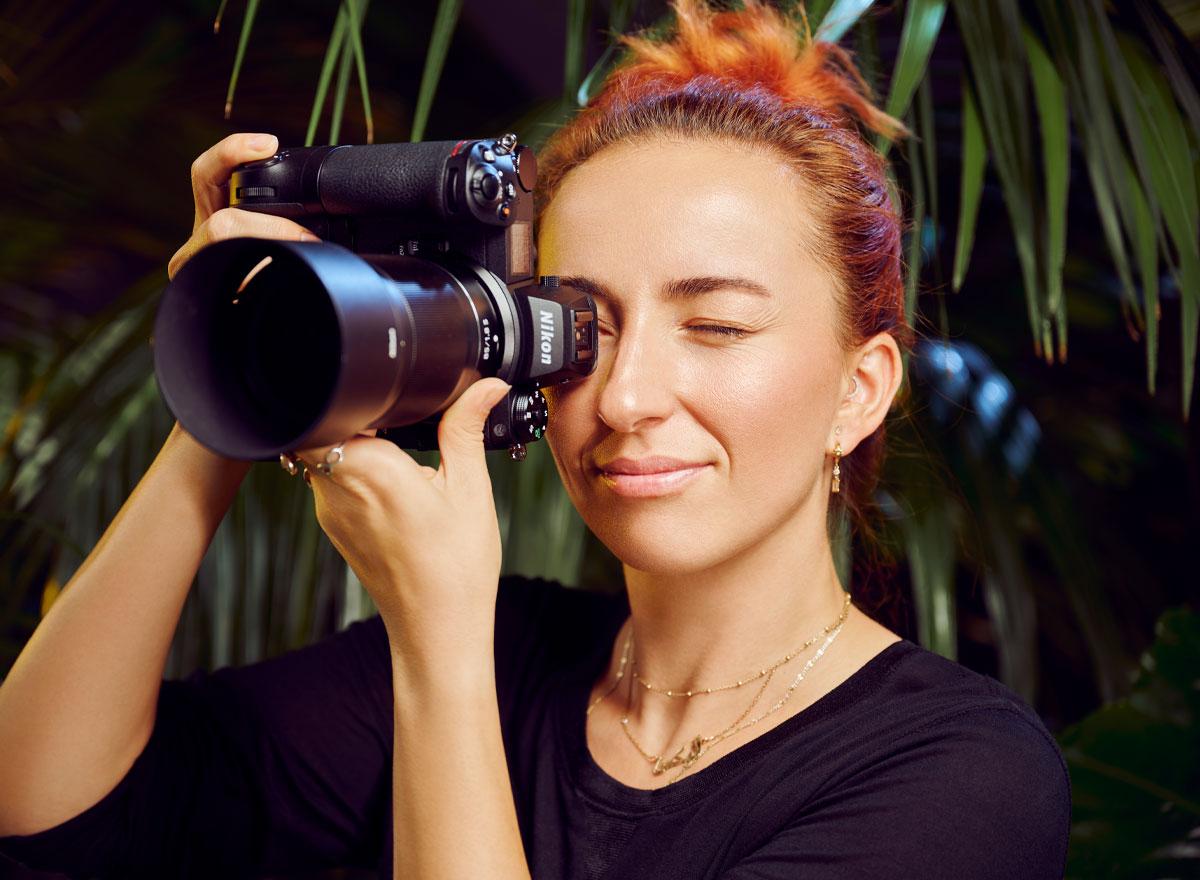 Woman taking photo with Z 7II