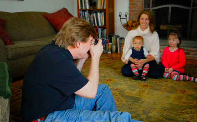 Joe McNally takes a photo of a family