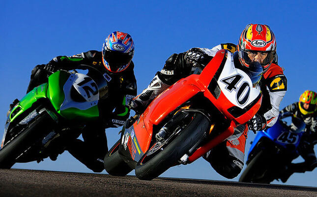 Sports action shot of a motorcycle race by Dave Black