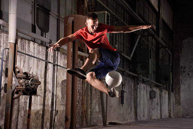 Photograph of a soccer player doing a trick