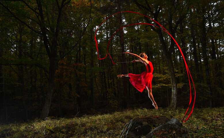 Professional photograph of a dancer in the woods