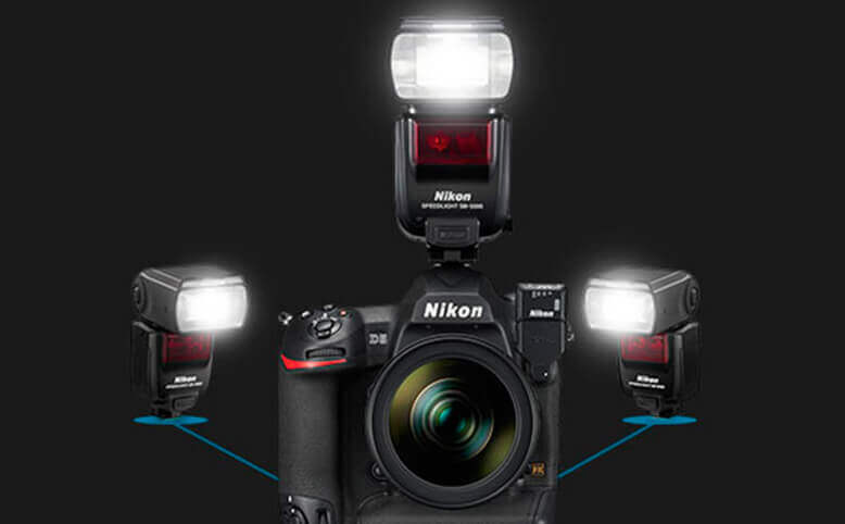 Nikon Speedlights externally attached to a camera