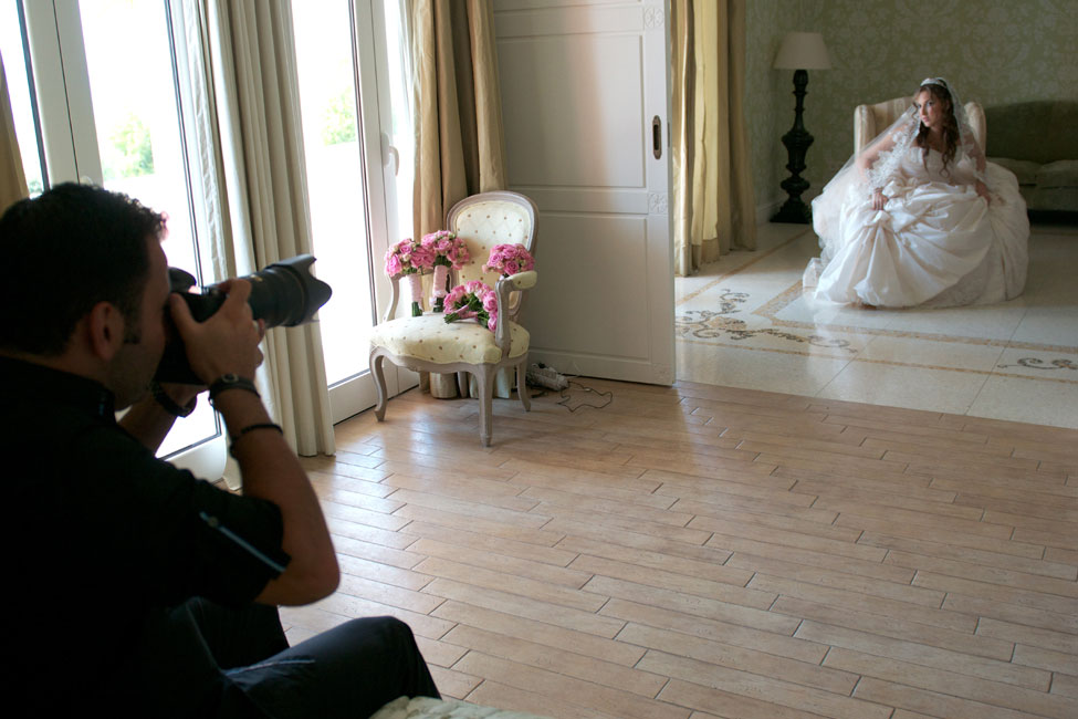 Wedding Photographer Jerry Ghionis Photographing A Bride