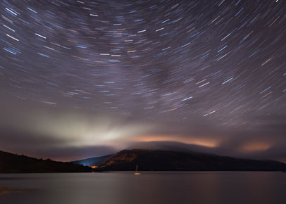 Photo of star trails over Scotland at night by Lance Keimig
