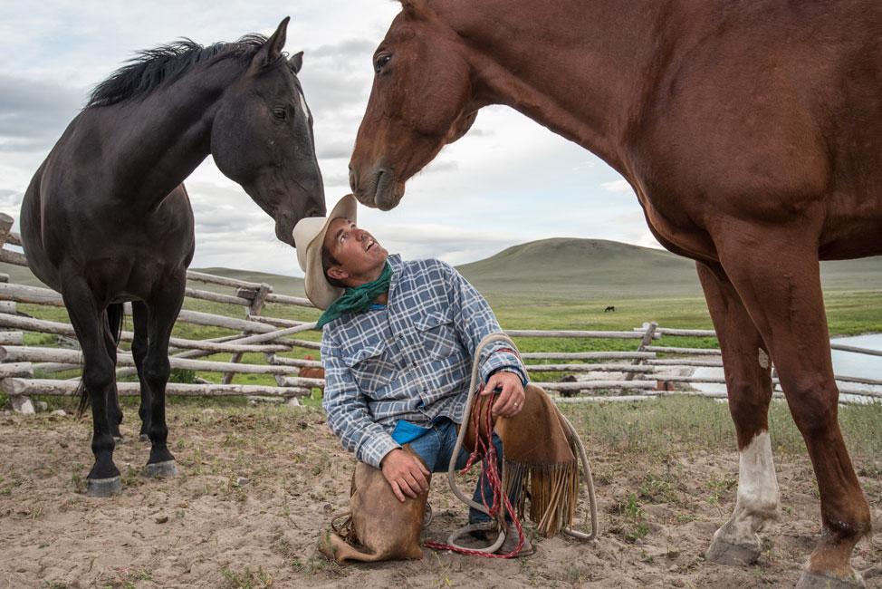 Nikon Ambassador Ami Vitale photo of a cowboy and two horses e7d41562f3dc
