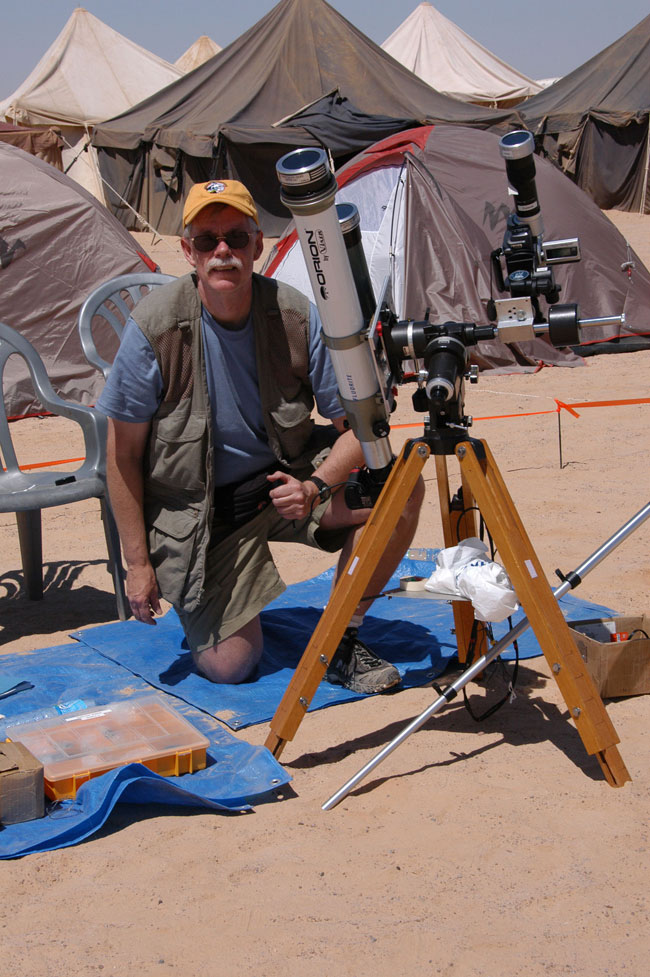 Photo of Fred Espenak with telescopes for solar eclipse