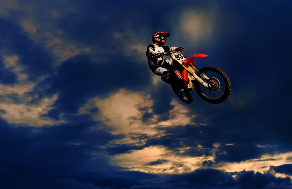 Dave Black Photo Of A Motocross Rider Jumping In Air Captured Using Flash And Stopping