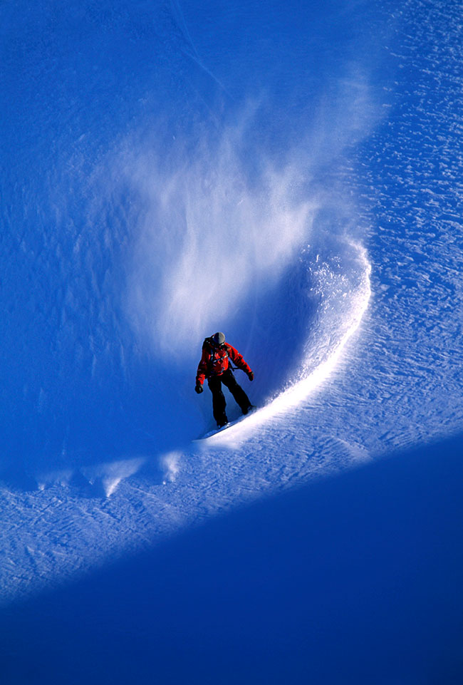Ski photography, Nikon Ambassador Corey Rich photo of a snowboarder in powder at Mt. Baker, Washington