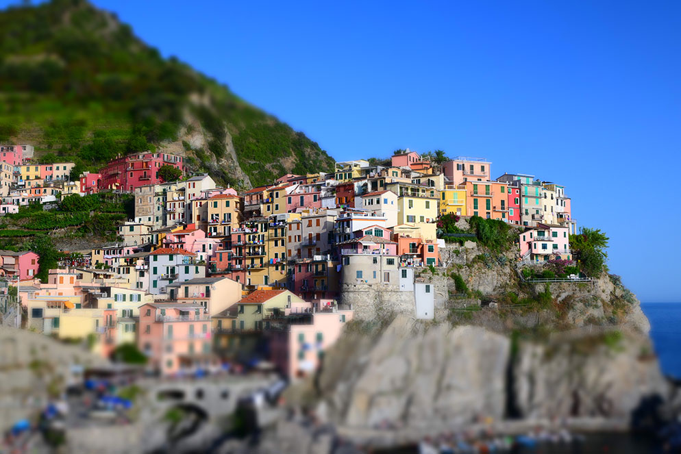 Alex Stead photo of a village on a cliff in Europe, taken using the Z 50 camera's miniature mode effect