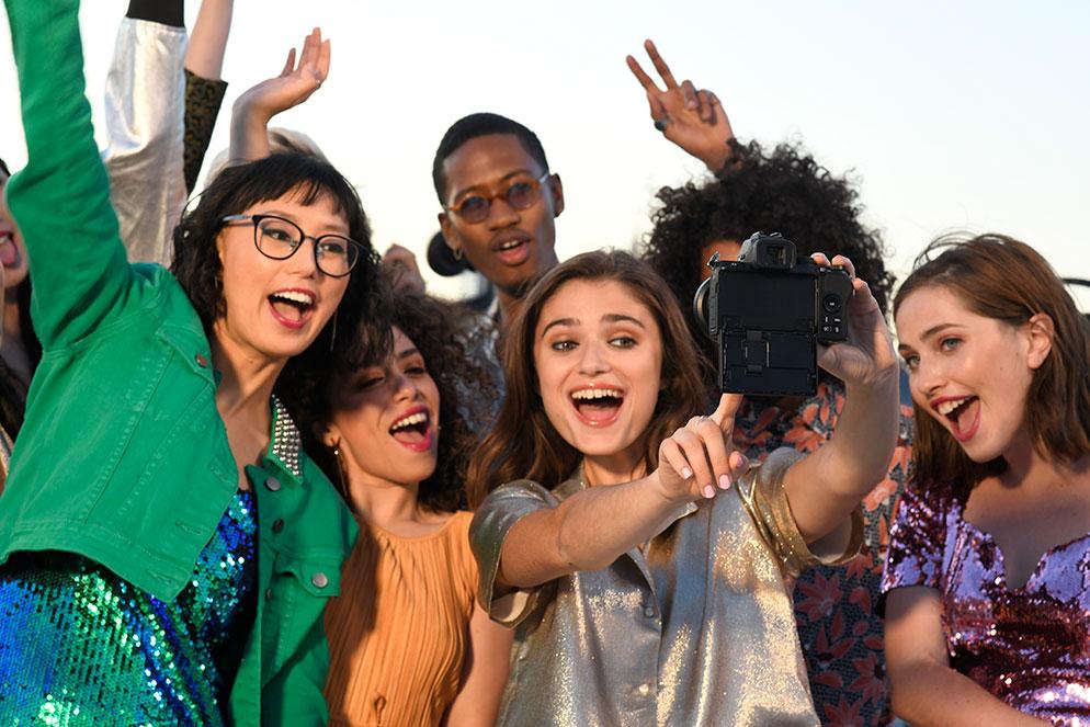 Gabriela Herman photo of a group of people taking a selfie