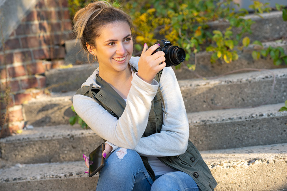 Mike Corrado photo of a young woman with the Z 50, composing a photo via the LCD