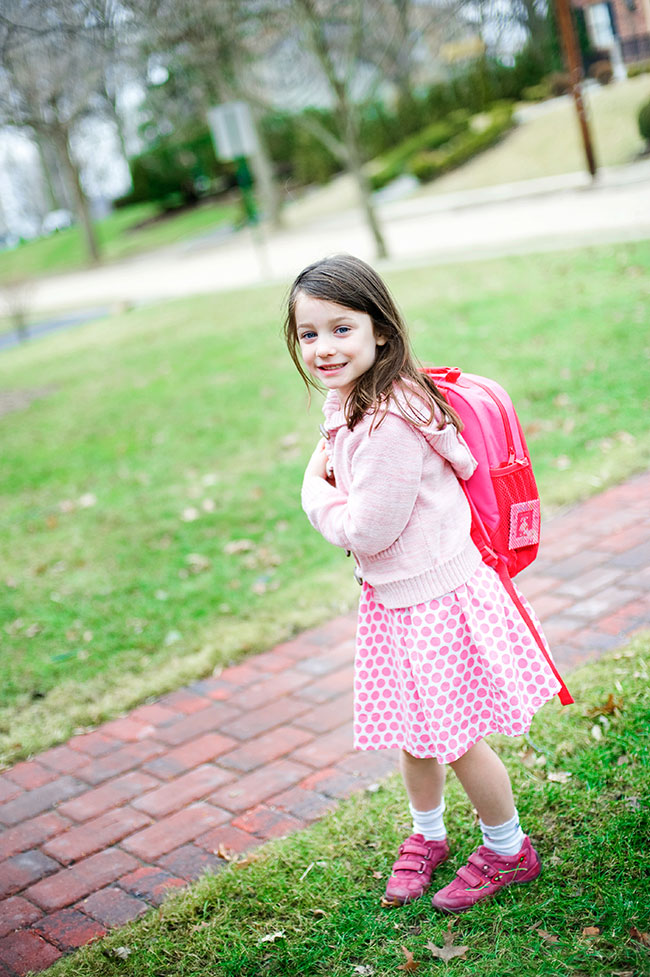 Kathy Wolfe photo of a young girl waiting for the school bus