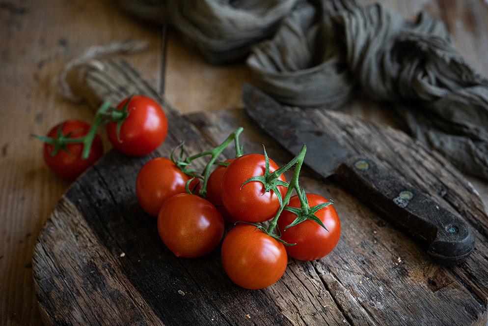 Photo of a bunch of tomatoes on a counter