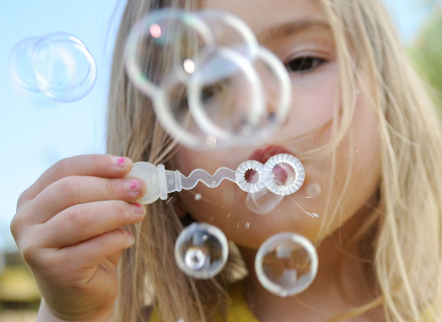Jamie Horton photo of a girl blowing bubbles