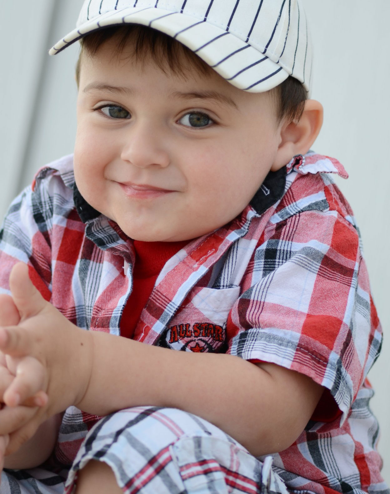 Diane Berkenfeld photo of a little boy looking at the camera smiling