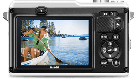 Nikon 1 AW1 with WU-1b wireless mobile adapter, showing sharing to a smartphone and tablet with an image of a woman canoeing on all the displays